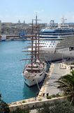 Malta cruise ships. A modern cruise liner and a tall ship at the cruise berth, Grand Harbour,  Valetta, Malta Royalty Free Stock Photos