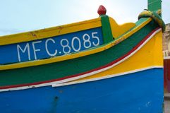 Malta: Scenic, high-colored fisherman boat. Malta: Details of scenic, high-colored fisherman`s boat, traditionally painted by unique palette of intense colors Royalty Free Stock Image
