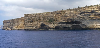 Malta, Dingli Cliffs. Breathtaking, spectacular, rugged, 220-250m-high cliffs on the south coast of the mainland island seen from a boat, Dingli Cliffs, Malta Royalty Free Stock Photos