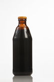 Malta drinks. Dark beer in a bottle, isolated on a white background Royalty Free Stock Photo