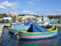 Malta fishing village. Traditional Malta boats moored at the picturesque fishing village of Marsaxlokk in Malta Royalty Free Stock Images