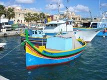 Malta fishing village. Traditional Malta boats moored at the picturesque fishing village of Marsaxlokk in Malta Stock Photos