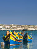 Malta Fishing Village. Traditional fishing boats of Malta in the fishing village of Marsaxlokk Stock Images