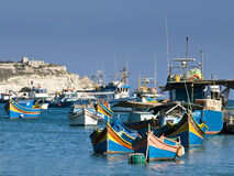 Malta Fishing Village. Traditional fishing boats of Malta in the fishing village of Marsaxlokk Royalty Free Stock Photography