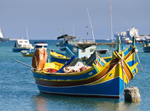 Malta Fishing Village. Traditional fishing boats of Malta in the fishing village of Marsaxlokk Royalty Free Stock Images