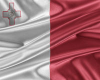 Malta flag with a glossy silk texture. Royalty Free Stock Photography