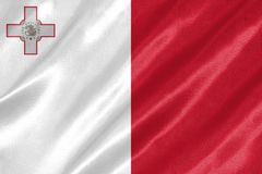 Malta Flag. With waving on satin texture royalty free stock image