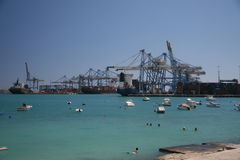 The Malta Freeport. Harbor, with swimming people in front Stock Image