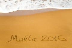 Malta 2016 geschreven in zand Stock Afbeelding