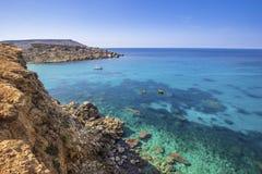 Malta - Ghajn Tuffieha bay view on a nice summer day with crystal clear water. Malta - Ghajn Tuffieha bay view on a nice summer day with crystal clear sea water Stock Photo