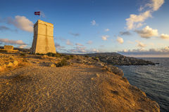 Malta - Ghajn Tuffieha watchtower at Golden Bay before sunset. Ghajn Tuffieha watchtower at Golden Bay before sunset Royalty Free Stock Photo