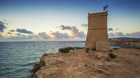 Malta - Ghajn Tuffieha watchtower at Golden Bay before sunset. Ghajn Tuffieha watchtower at Golden Bay before sunset Royalty Free Stock Image