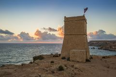 Malta - Ghajn Tuffieha watchtower at Golden Bay before sunset. With amazing blue sky Royalty Free Stock Photo