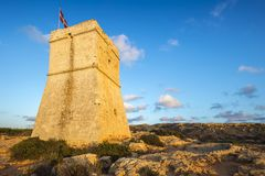 Malta - Ghajn Tuffieha watchtower at Golden Bay before sunset. With blue sky Royalty Free Stock Photos