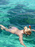 Malta. Girl snorkeling in blue water Malta Royalty Free Stock Photos