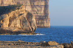 Malta, Gozo, Dwejra cliffs. Dwejra cliffs under evening sun. Gozo island, Malta Royalty Free Stock Image