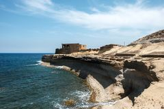 Malta and Gozo islands as tourist destinations. Salt pans and abandoned building at Gozo islands, Malta Stock Photography