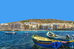 Malta - Gozo, Marsalforn. View of the old fishing village of Marsalforn, an important tourist resort, lined with hotels and apartment buildings Stock Photography
