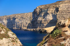 Malta. Gozo. Xlendi's bay. Malta. Gozo. Azure bay against rocks Royalty Free Stock Images