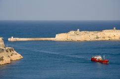 Malta Grand Harbor Entrance, Valletta. View from Valletta to the harbor entrance and Fort Ricasoli with an incoming ship Stock Image