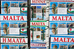 Malta guide books. A close up of Guide books for Malta displayed in a stand outside of a shop Stock Images