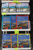 Malta guide books. A close up of guide books for Malta displayed in a stand outside of a shop Stock Photo