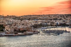 Malta: Il-Gzira and Marsans Harbour. Aerial view from city walls of Valletta at sunset Stock Photos