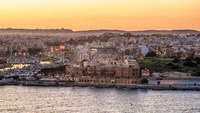 Malta: Il-Gzira and Marsans Harbour. Aerial view from city walls of Valletta at sunset Stock Photo
