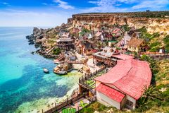 Malta, Il-Mellieha - Popeye village. Malta, Il-Mellieha. View of the famous village Popeye and bay on a sunny day. Malta Stock Image