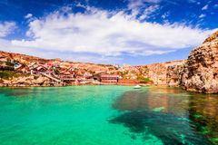 Malta, Il-Mellieha - Popeye village. Malta, Il-Mellieha. View of the famous village Popeye and bay on a sunny day. Malta Royalty Free Stock Photo