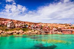Malta, Il-Mellieha - Popeye village. Malta, Il-Mellieha. View of the famous village Popeye and bay on a sunny day. Malta Stock Images
