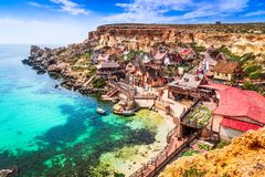 Malta, Il-Mellieha - Popeye village. Malta, Il-Mellieha. View of the famous village Popeye and bay on a sunny day. Malta Royalty Free Stock Image