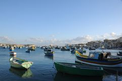 Malta Island: The fisher-harbour of Marsaxklokk. The fisher-harbour from Marsaxklokk on Malta Island with colourfull fisher-boats Royalty Free Stock Photography