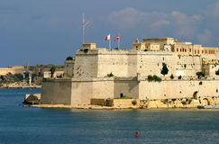 Malta La Valletta fort. Malta La Valletta Panoramic view of historic city and fortified walls from harbor - UNESCO World Heritage Site Stock Photography