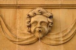 Malta La Valletta fountain. Malta La Valletta allegoric fountain detail - face carved in sanstone Stock Photo