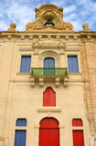 Malta La Valletta Late baroque Facade. Malta La Valletta baroque sandstone facade with colorful shuttered doors and windows in the waterfront Royalty Free Stock Images