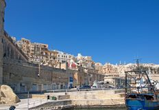 Malta, Landscape of the Old Port of Valletta. Unique landscape of the Old Port of Valletta, Malta. There is an old fisherman ship and old, city buildings Stock Photography