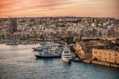 Malta: Manoel Island, Il-Gzira and Marsans Harbour. Aerial view from city walls of Valletta at sunset Royalty Free Stock Images