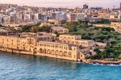 Malta: Manoel Island, Il-Gzira, Sliema and Marsans Harbour. Aerial view from city walls of Valletta at sunset Royalty Free Stock Image