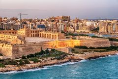 Malta: Manoel Island, Il-Gzira, Sliema and Marsans Harbour. Aerial view from city walls of Valletta at sunset Stock Images