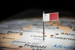 Malta marked with a flag on the map.  royalty free stock photo