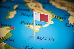 Malta marked with a flag on the map.  royalty free stock images