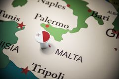 Malta marked with a flag on the map.  royalty free stock photography