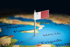 Malta marked with a flag on the map.  stock image