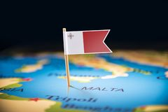 Malta marked with a flag on the map.  stock photo