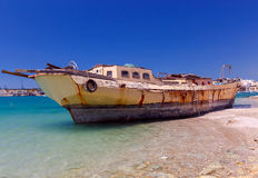 Malta. Marsachlokk. The old ship. Old fishing boat on the shallows near village of Marsaxlokk. Malta Stock Images