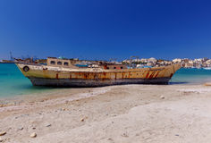 Malta. Marsachlokk. The old ship. Old fishing boat on the shallows near village of Marsaxlokk. Malta Royalty Free Stock Photo
