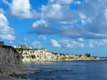 Malta, Marsaskala St. Thomas` Bay. Dream holidays. A picturesque view on a bay. White clouds Stock Photography