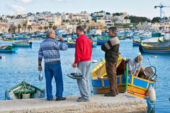 Malta - Marsaxlockk. Fishermen on the port of Marsaxlockk in Malta Stock Images