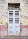 Malta, Marsaxlokk: Scenic, retro door of a village houses. Attractive high-colored fishermen houses in the port of the village Marsaxlokk, Malta. Traditionally Royalty Free Stock Photography